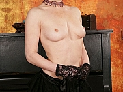 Horny milf blonde in stockings poses on piano