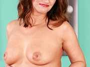 Susie Lovah in stockings toys a pink dildo