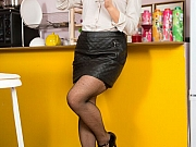 Yulenka Moore in black stockings strips on kitchen