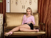 Evey Kristal sexy blonde in pantyhose strips on couch