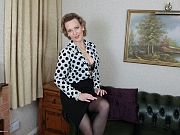 Betsy Blue poses in black lingerie and stockings