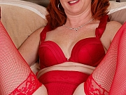 Sasha Brand redhead milf in lingerie and stockings shows hairy pussy