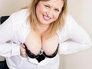 Busty amateur milf blonde in black stockings strips