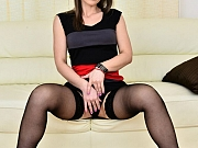 Angel Karyna in black stockings shows a striptease