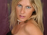 Milf blonde with big round boobs poses naked
