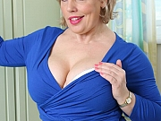 Danielle Tee busty blonde in blue dress and stockings strips