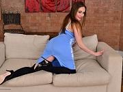Sophia Delane busty milf in black stockings strips on a sofa