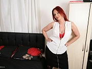 Redhead mom in red lingerie and stockings strips