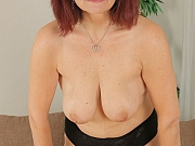 Busty mature in stockings toying a hairy pussy