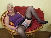 Winnie Anderson busty mature blonde in stockings